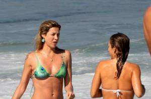 Luana Piovani e Pedro Scooby curtem dia ensolarado em praia do Rio