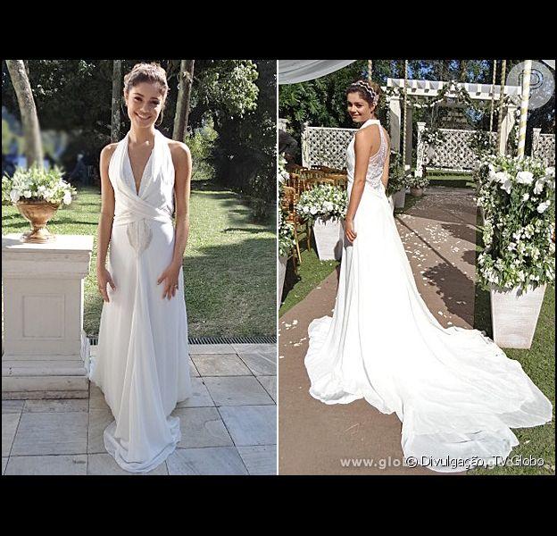 Amora (Sophie Charlotte) usa vestido de noiva com uma longa cauda e decote frontal. A cena do casamento vai ao ar em 5 de setembro de 2013