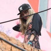 Modelo Cara Delevingne faz ensaio no morro Dona Marta e se arrisca em muro
