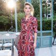 Acessórios que mudam o look: as botas de cowboy escolhidas por Amber Heard para assistir o desfile da Valentino dão peso ao vestido delicado e feminino
