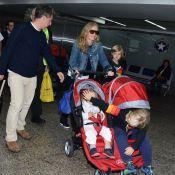 Luciano Huck e Angélica desembarcam com os três filhos em aeroporto de SP