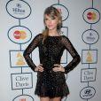 Taylor Swift escolheu um modelito curto zuhair Murad para a festa do Grammy 2014