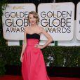 Taylor Swift investe em longos de tecidos nobres. Para o tapete vermelho do Globo de Ouro 2014, a cantora escolheu um Carolina Herrera