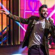 Gusttavo Lima foi ovacionado por reação a fã que jogou água nele em show