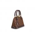 Bolsa Louis Vuitton possui a icônica estampa Damier Ébène, que tem suas origens em um modelo Art Déco, apresentado em 1934