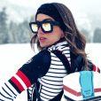 Anitta vem desfilando looks grifados na neve