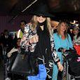Fergie chega ao aeroporto de Los Angeles, na Califórnia, em 2 de março de 2013