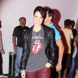 No Rock in Rio de 2011, Paolla Oliveira escolheu um look despojado com uma pegada rocker. Ela usou uma calça bordô, combinada com jaqueta de couro preta