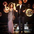 O canal Viva reprisou, no final de 2014, edições dos anos 1980 do 'Globo de Ouro' e Marcio Garcia e Juliana Paes foram os apresentadores