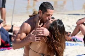 Cleo Pires e José Loreto trocam beijos durante filmagem em praia do Rio