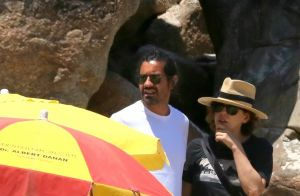 Barbara Paz usa maiô comportado para curtir praia com namorado. Fotos!