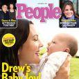 Drew Barrymore vai doar cachê recebido pelas fotos da filha, Olive, na revista 'People', em dezembro de 2012