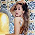 Anitta exibe tatuagem no bumbum em foto de maiô