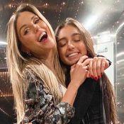 Flávia Viana se encanta ao filmar a filha, Sabrina, ninando irmão recém-nascido
