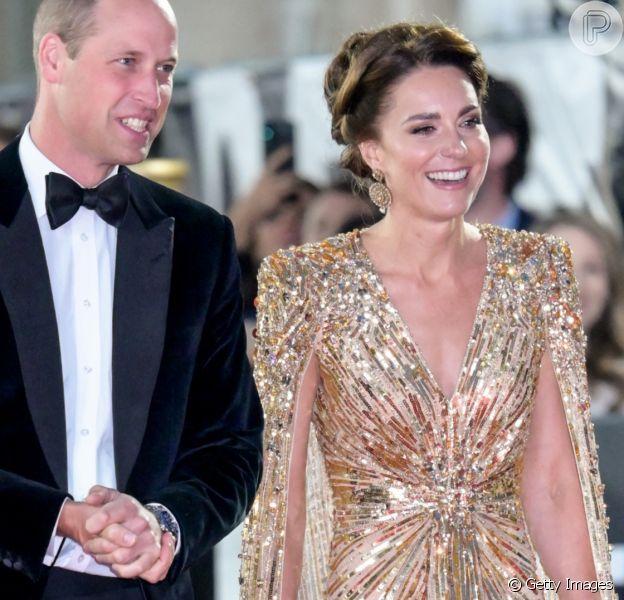 Vestido com capa e tributo à Diana: tudo sobre o look dourado de Kate Middleton em premier