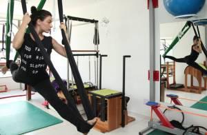 Isis Valverde chama a atenção por elasticidade durante aula de pilates. Fotos!